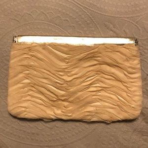 Nude ruffled clutch with rose gold trim